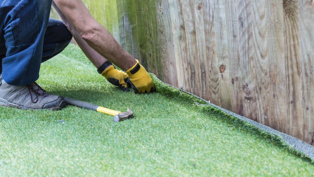 Artificial grass being installed by one of our expert staff