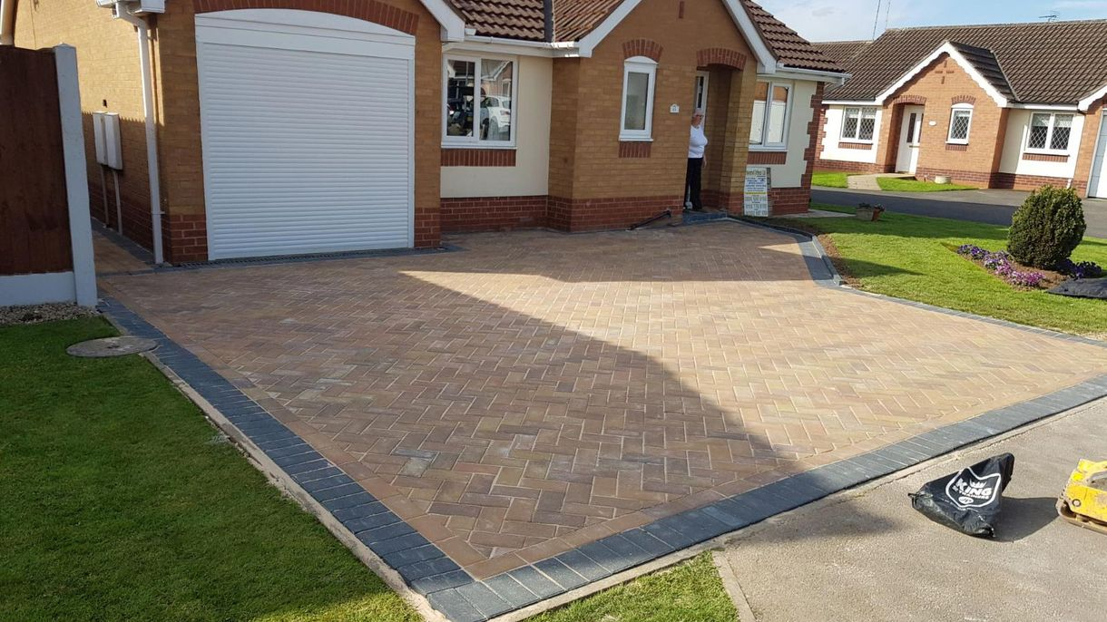 A brand new driveway outside a home