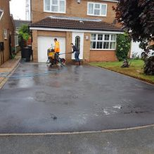 A new tarmacked driveway that has been added to a home in Barnsley